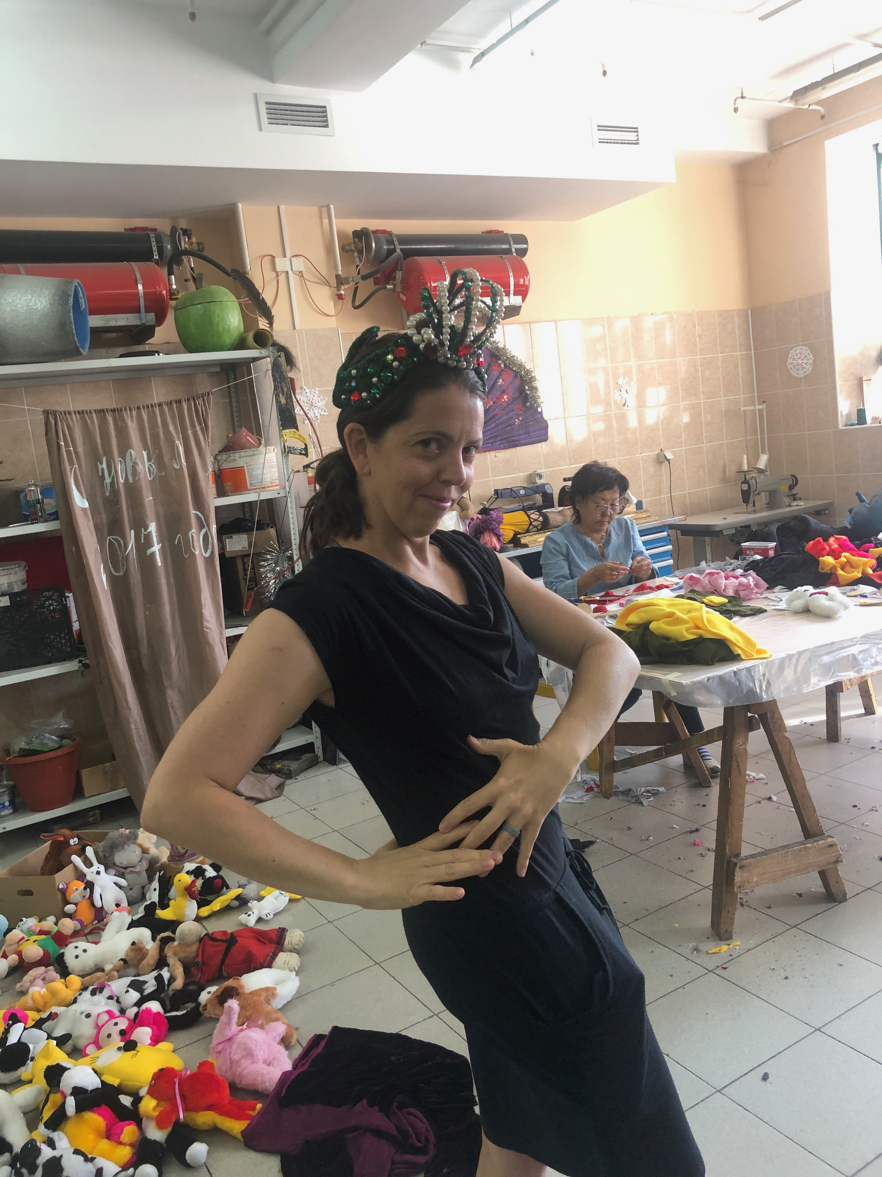 Erin trying on costume at ballet and opera theater in Ulan-Ude
