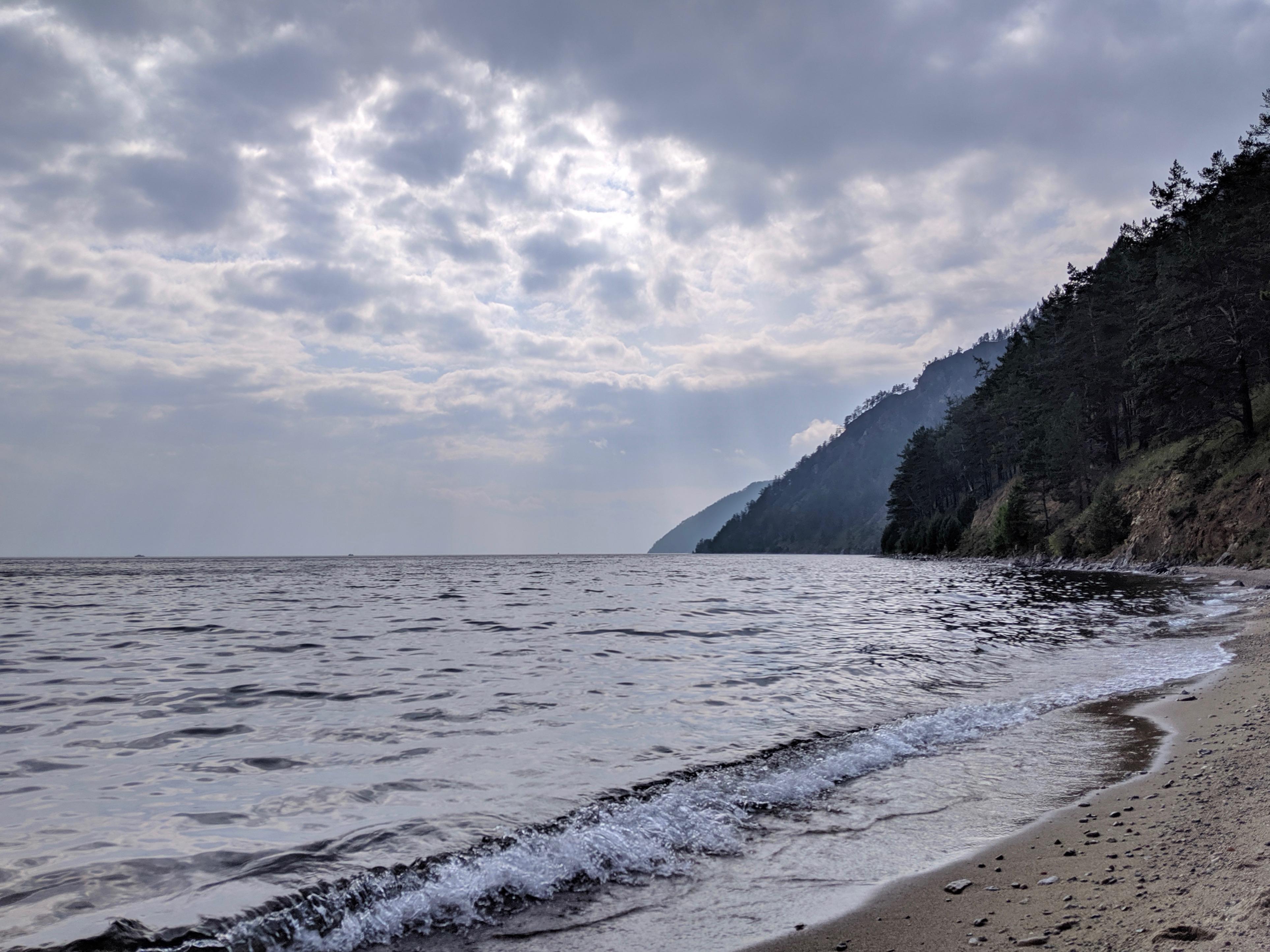 Hiking the pebble beach along Lake Baikal