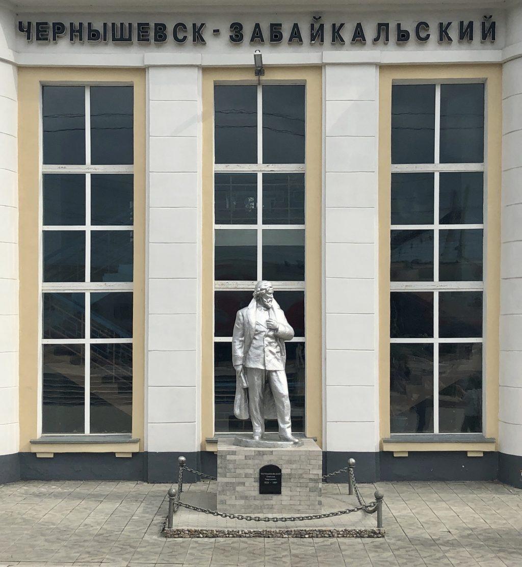 Nikolai Chernyshevskiy standing stately in the Chernyshevsk Station